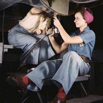 Women working on a plane, lookimg capable and stylish