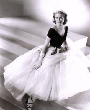 Grace Kelly wears dress designed by Edith Head for the film Rear Window, 1954