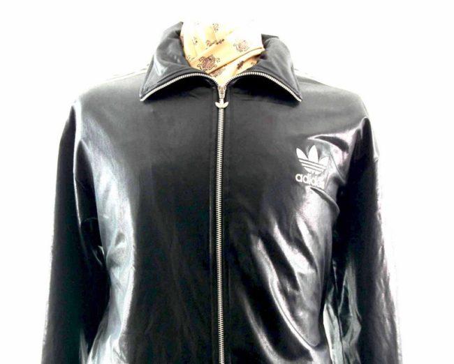 Close up of 90s Shiny Black Adidas Track Jacket