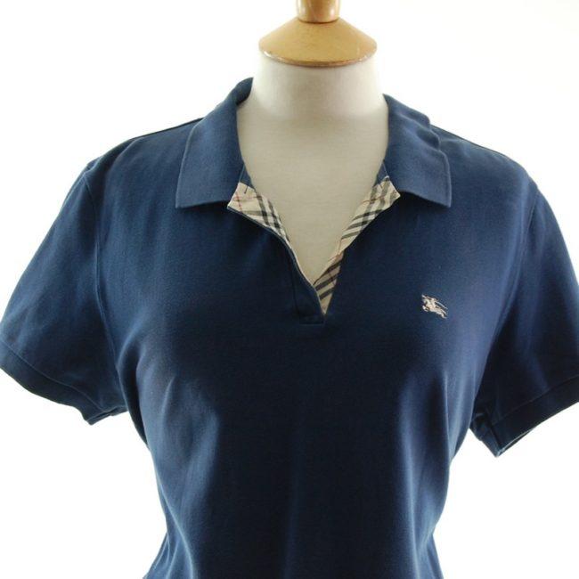 Close up of Ladies Dark Blue V Neck Burberry Polo Shirt