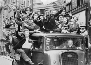 Seamstress, Tailor, Soldier, Spy. A truck full of people parading through the Strand, London, Ve Day Celebrations , 8 May 1945