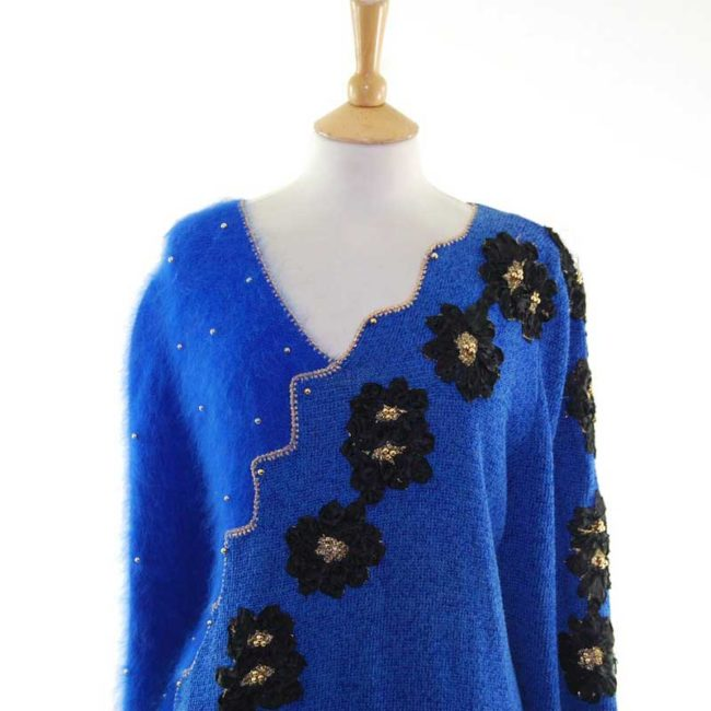 Close up front Blue Angora And Cotton 80s Sweater With Black Appliqued Flowers