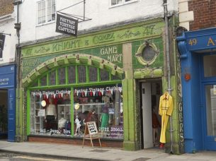 cheap retro clothing shop front with signage, original tiling & windows