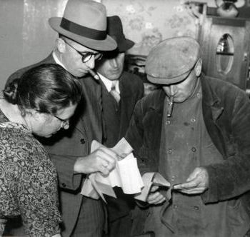 what are the best workwear jacket brands.One Woman and two Men , one wearing workwear jacket, Netherlands, 1941