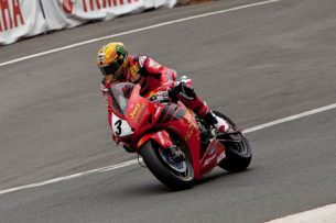 What are the best motorcycle jacket brands-John McGuinness riding at the Dainese Superbike TT 2013