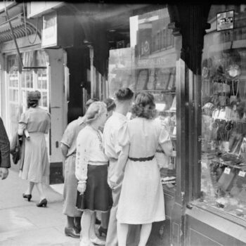 40s Ladies Fashion-Young men and women look in the window of a jeweller's shop on Silver Street in Durham, England, UK, 1943