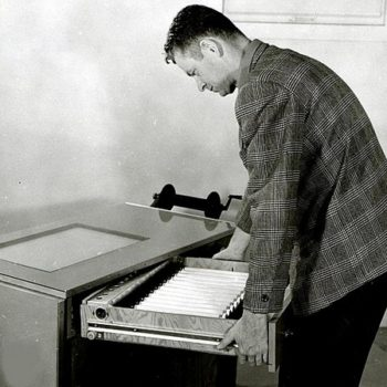 Vintage office wear-John Wear with office light table drawer open, 1958 Portland, Oregon.Photo by Wally C.Guy