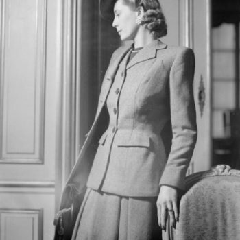 40s 50s Fashion - model wears a wool checked suit by fashion designer Hardy Amies, 1945