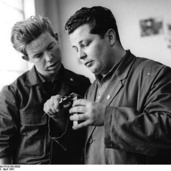 French work jacket - Two engineers in work jackets conferring