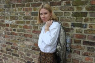 Alex models Leopard print trousers and white long sleeved blouse