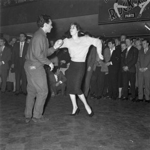 Rockabilly couple jiveing at Rock and Roll dance in 1957