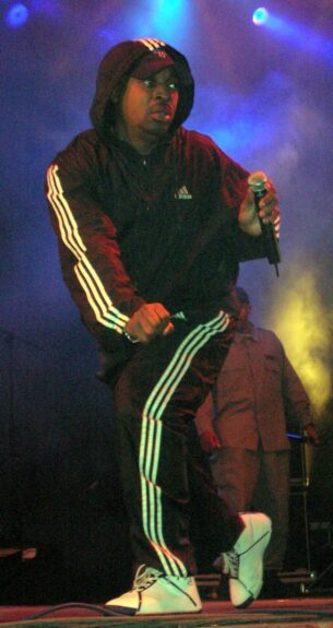 Chuck D in Adidas shell suit top and Adidas shell suit bottoms