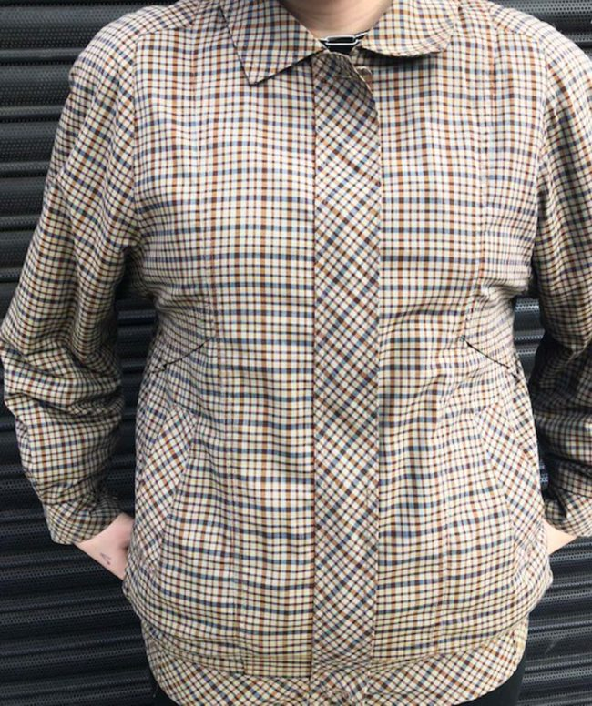 close up of 80s Small Brown Check Bomber Jacket
