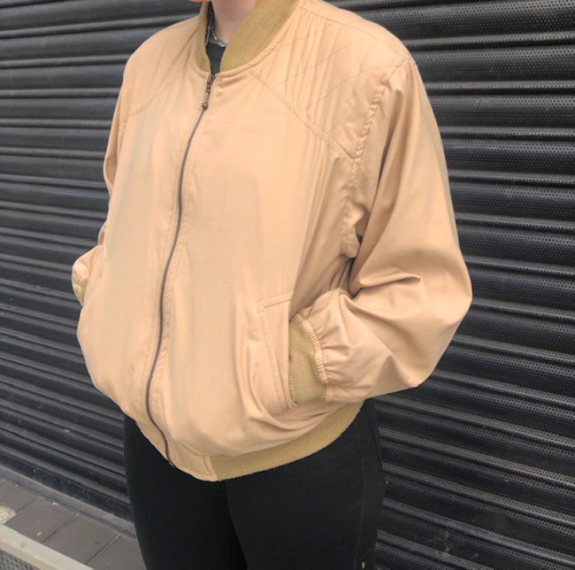 side of 80s Light Beige Retro Bomber Jacket