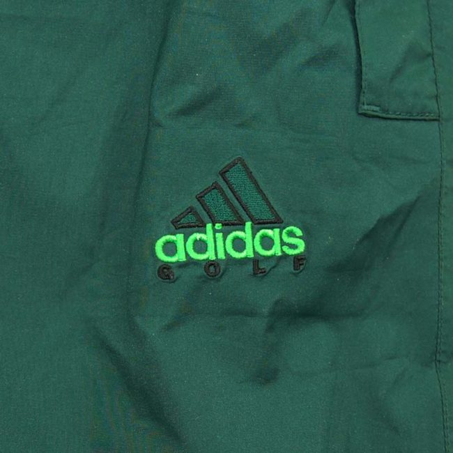 label of 90s Green Adidas Golfing Trackie Bottoms