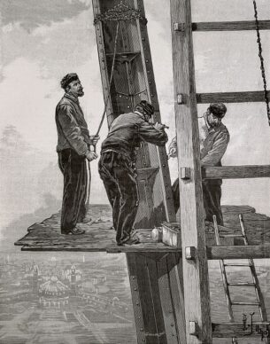 French chore jackets with construction workers standing on an elevated platform on the Eiffel Tower, 1889