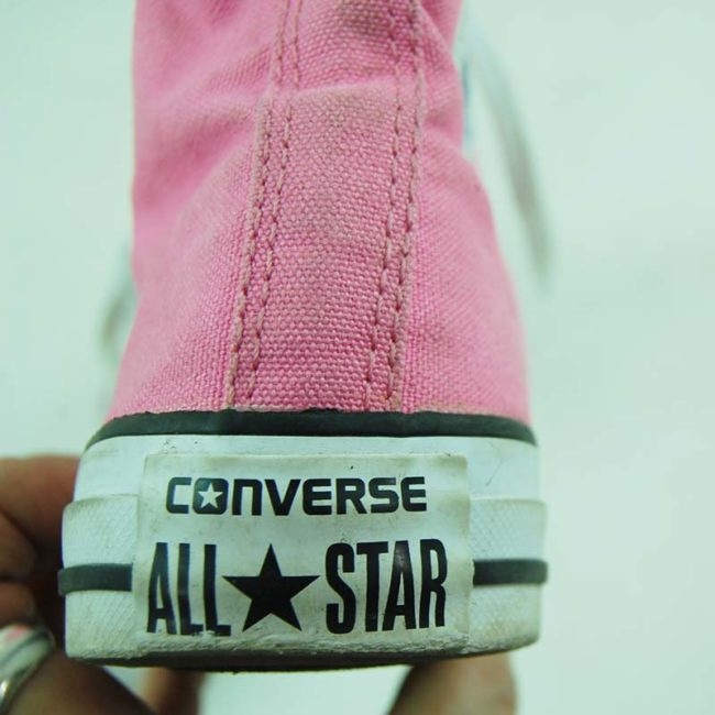 back of 90s Vibrant Pink Converse Sneakers