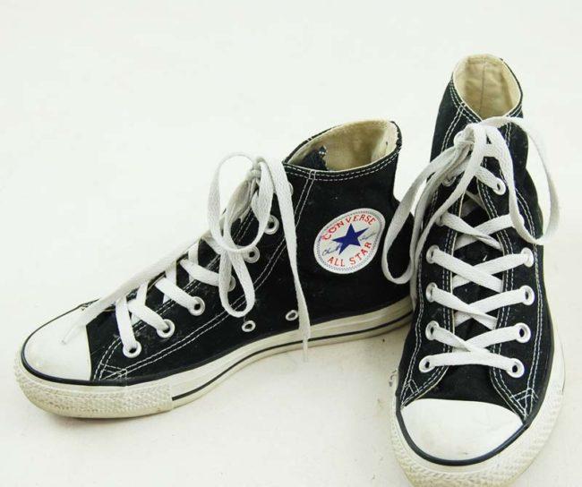 side of Black Ladies Converse Sneakers
