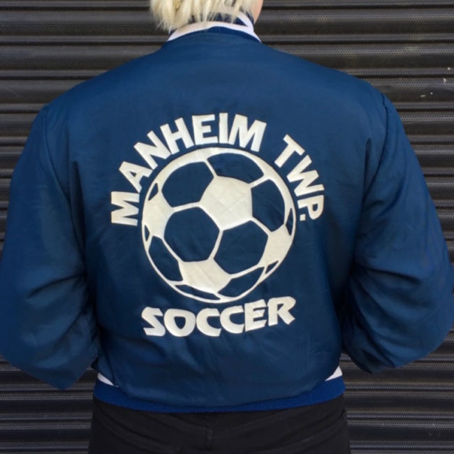 back of Soccer Club Baseball Jacket