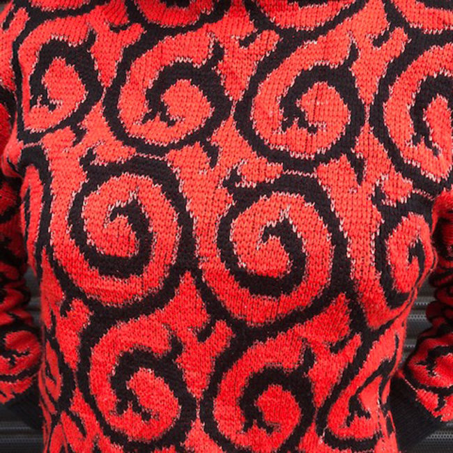 close up of 80s Red Glitter And Black Jumper