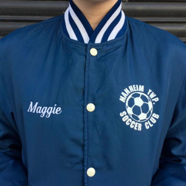 close up of Soccer Club Baseball Jacket