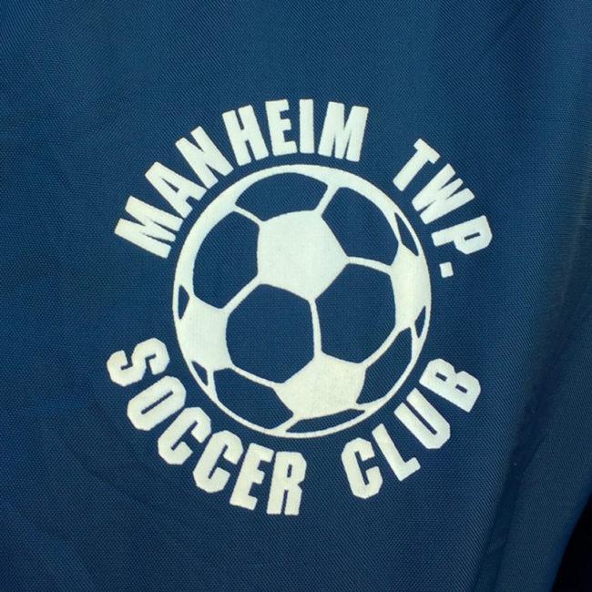 left side of Soccer Club Baseball Jacket