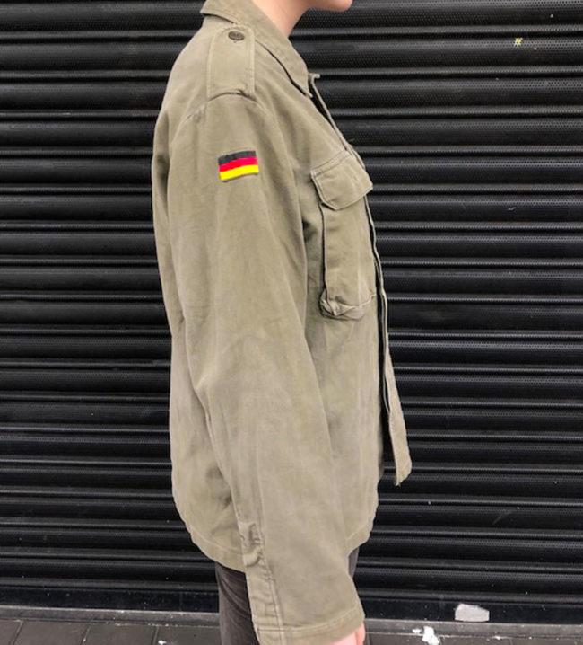 side of Plain Green German Camouflage Jacket