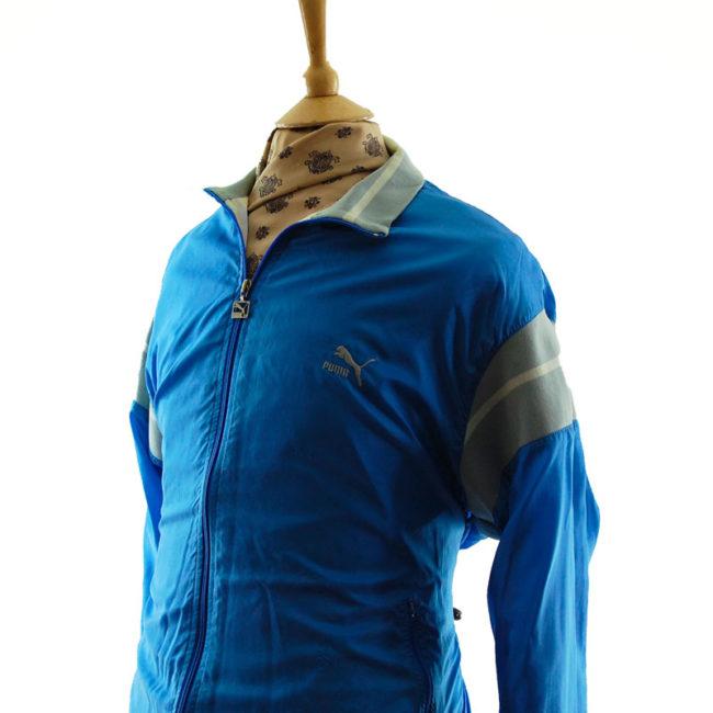 side of Puma Baby Blue Windbreaker Jacket
