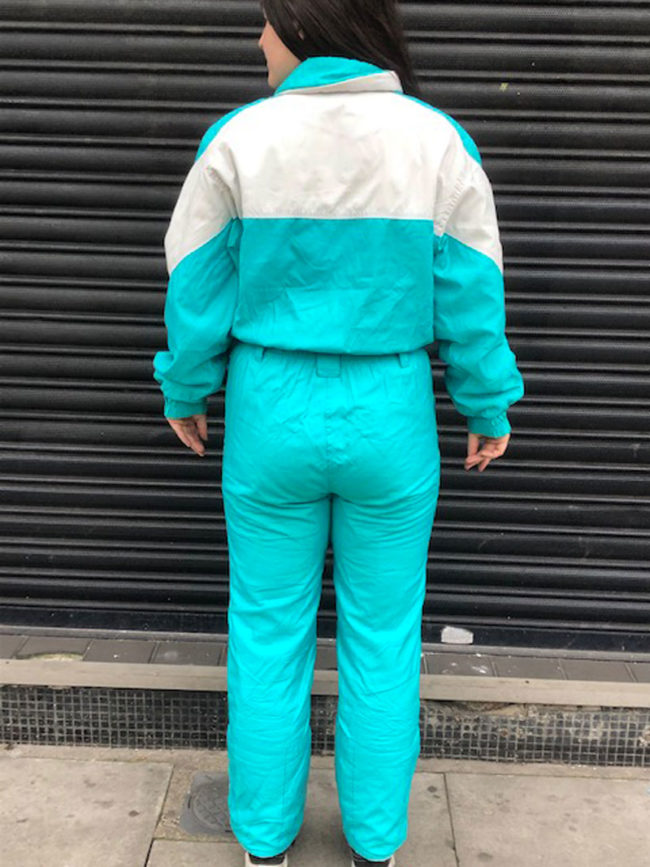 back of Volkl Teal Skiing Suit