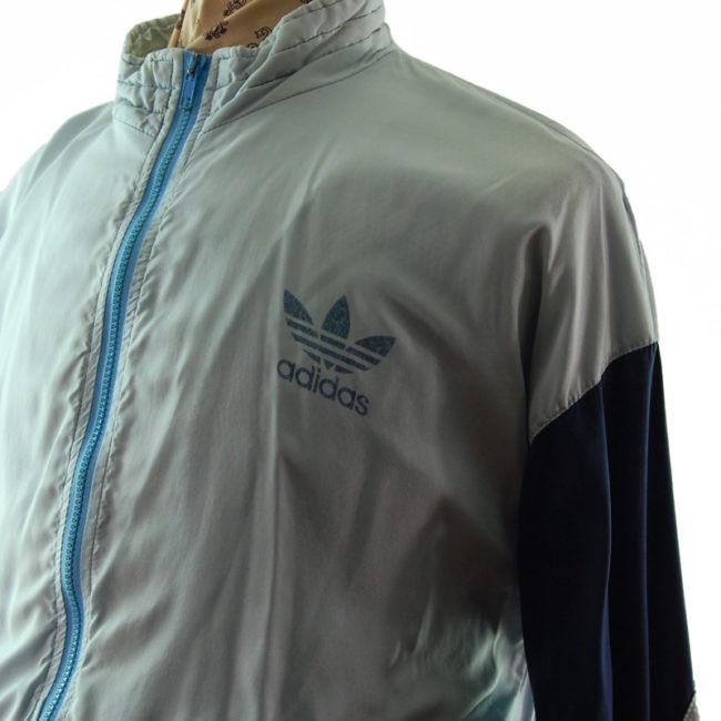 close side of Adidas Grey And Blue Windbreaker