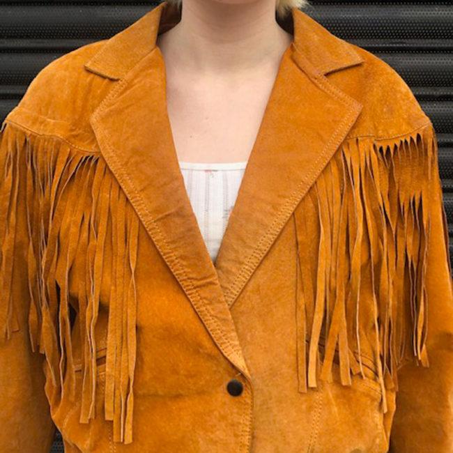 close up of 90s Orange Suede Fringed Jacket