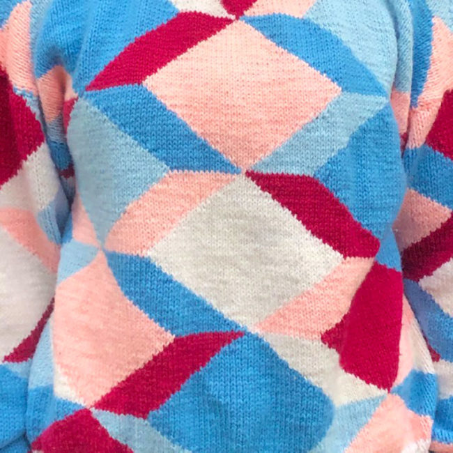 close up of 80s Multicolored Geometric Shapes Sweater