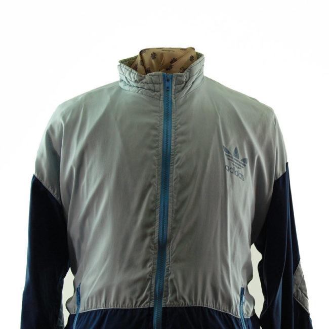 close up of Adidas Grey And Blue Windbreaker