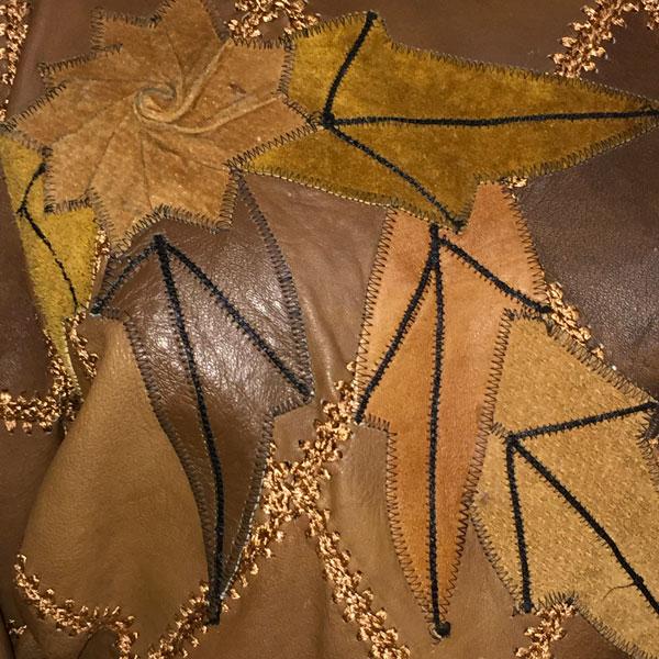 close up of Vintage Brown Diamond Patchwork Jumper