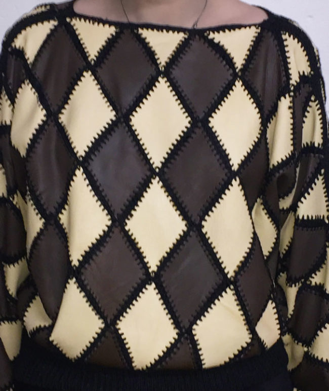 close up of White And Brown Diamond Patchwork Jumper