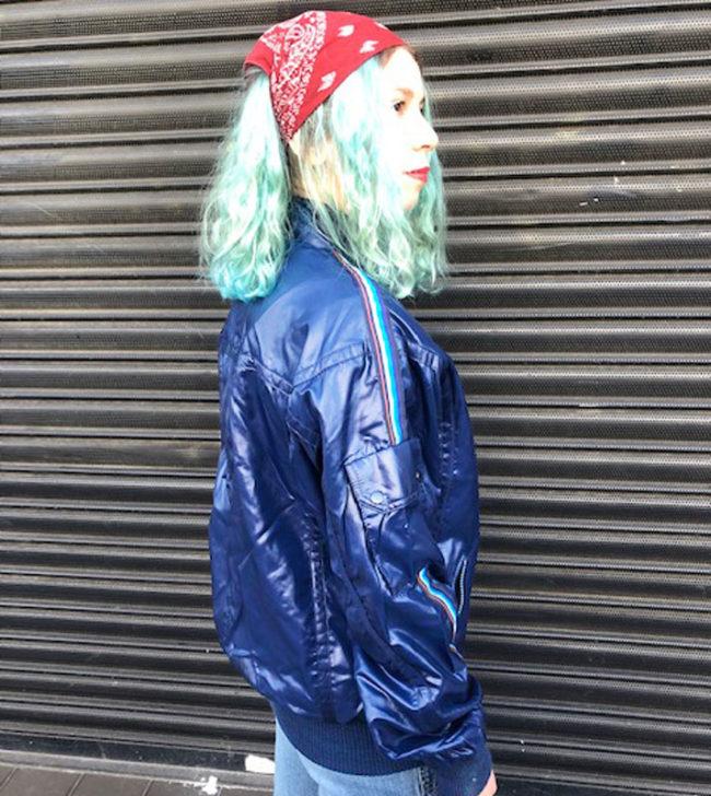 side of Rare Sachs Sporting Dark Blue Jacket