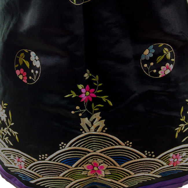 Traditional Hanfu Robe pattern Features a black block colour shirt with embroidered flowers and hills on the hemline with embroidered flowers.