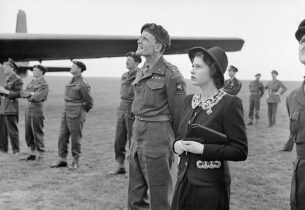 The Queen loves pockets too! HRH Princess Elizabeth watching parachutists dropping during a visit to airborne forces in England, 1944