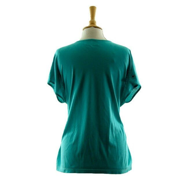 Back of Womans Turquoise Floral 80s Print T Shirt