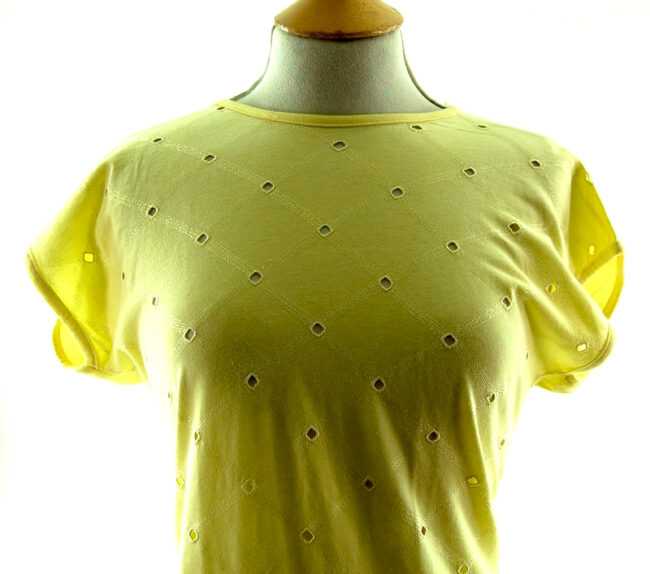 Close up front of Womans Pale Yellow 80s t shirt