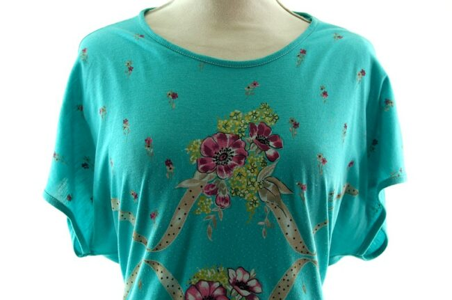 Close up of front Womans Turquoise Floral 80s Print T Shirt