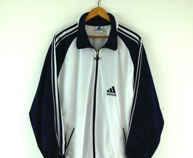 Adidas white track jacket close up