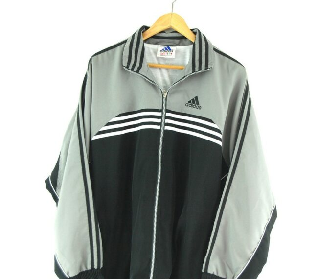 Adidas Track jacket with front stripes close up