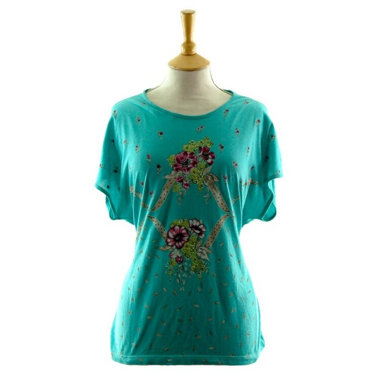 Front of Womans Turquoise Floral 80s Print T Shirt