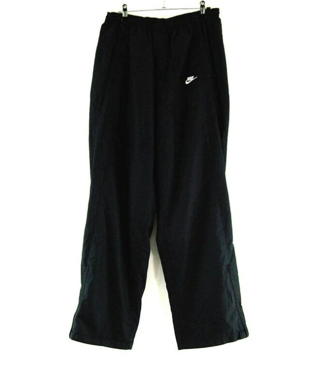 BLACK NIKE SHELL SUIT TROUSERS