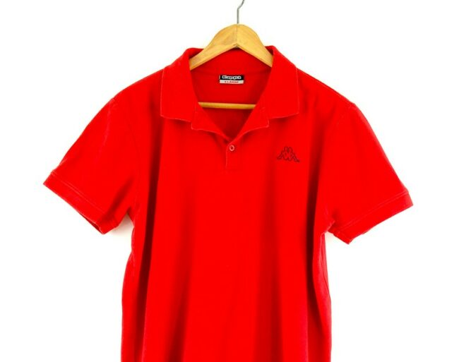 Red Kappa polo shirt close up