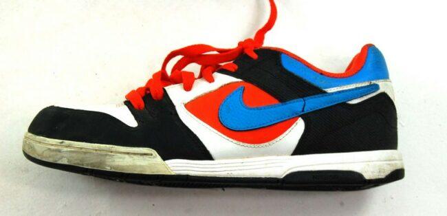 Side of Black And Orange Nike Trainers