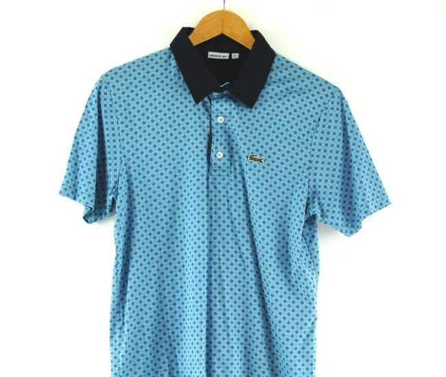 Close up of Lacoste blue Polo Top