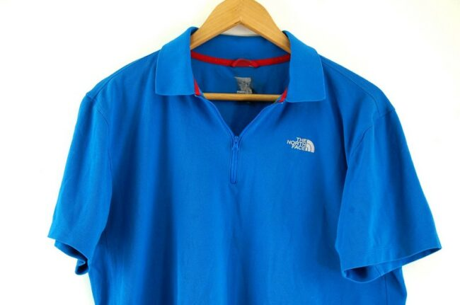 Close up of Blue The North Face Polo Shirt