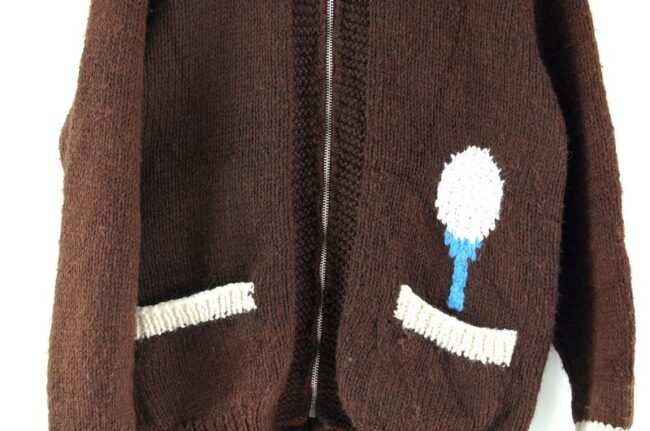 Close up of Cowichan Sweater Golf Themed
